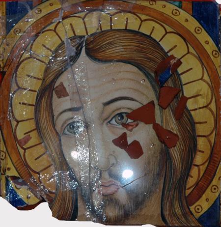 santo con frammenti